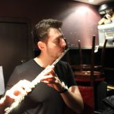 Brandon Wright warming up the flute